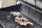 Inktvis en vlees op de gril